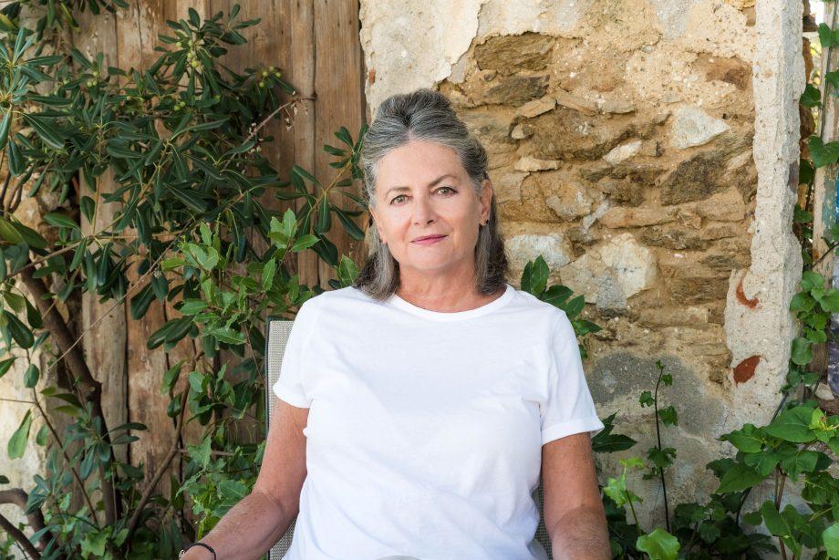 Woman in white T-shirt sitting in garden
